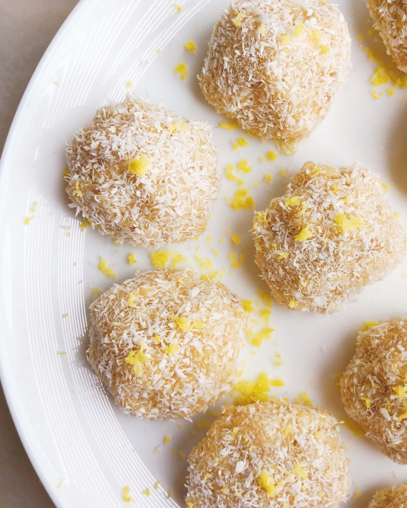 Healthy Lemon Coconut Ginger Balls! No-bake vegan treats bursting with refreshing flavor. SO EASY to make. Perfect for an afternoon snack or an after dinner treat! #healthydesserts #nobakedesserts #easysnackrecipes #healthysnack #veganrecipe | www.jillzguerin.com