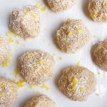 Healthy Lemon Coconut Ginger Balls! No-bake vegan treats bursting with refreshing flavor. SO EASY to make. Perfect for an afternoon snack or an after dinner treat! #healthydesserts #nobakedesserts #easysnackrecipes #healthysnack #veganrecipe