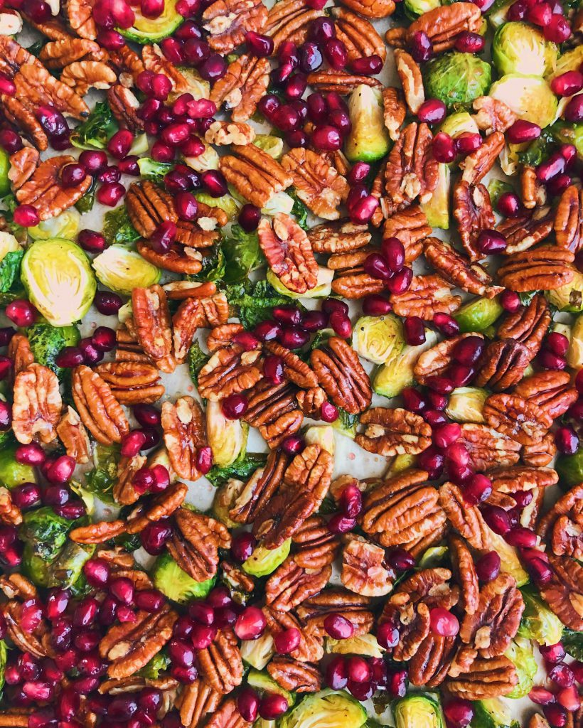 Pecan And Pomegranate Seed Brussels Sprouts: A delicious and nutrient-filled side dish perfect for holiday parties and the winter season. #healthyfood | www.jillzguerin.com